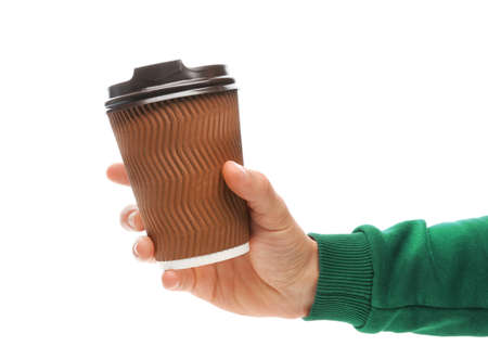 Man holding takeaway paper coffee cup on white background Foto de archivo