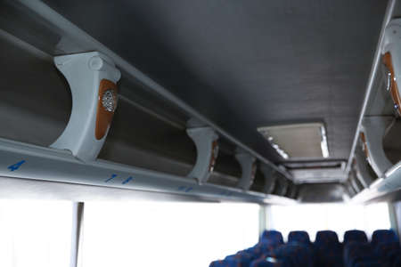 View of bus interior with shelves for luggage