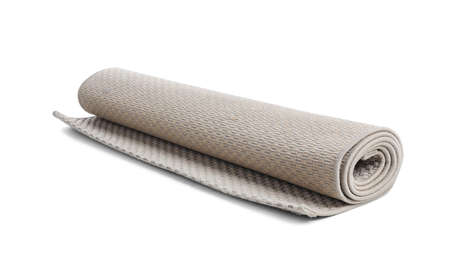 Rolled grey carpet on white background. Interior element