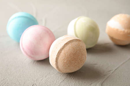 Colorful bath bombs on grey background. Spa product