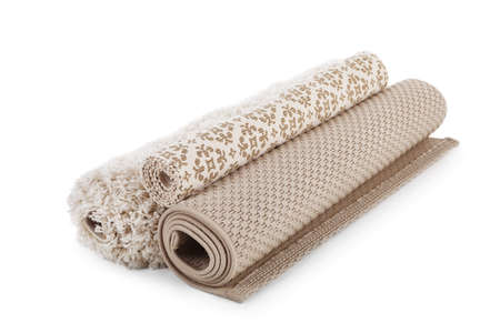 Different rolled carpets on white background. Interior element
