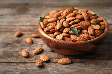 Tasty organic almond nuts in bowl on table 스톡 콘텐츠