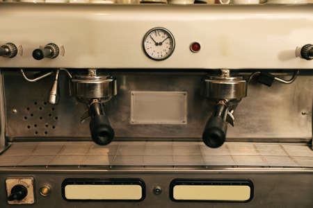 Modern electric coffee machine with portafilters, closeup Foto de archivo - 112393350