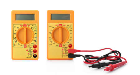 Set with digital multimeters on white background. Electrician's tool