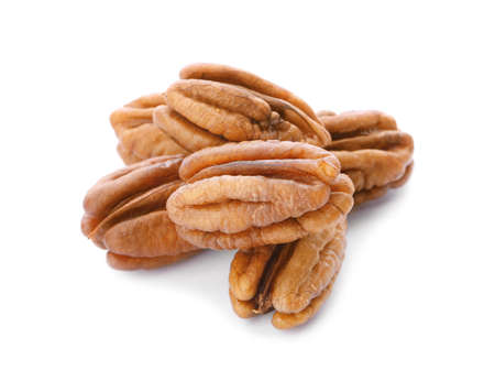 Heap of ripe shelled pecan nuts on white background
