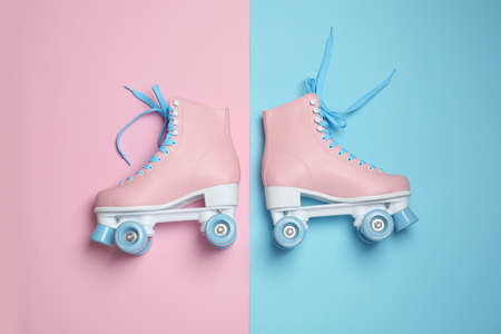 Pair of stylish quad roller skates on color background, top view Archivio Fotografico