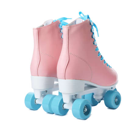 Pair of stylish quad roller skates on white background