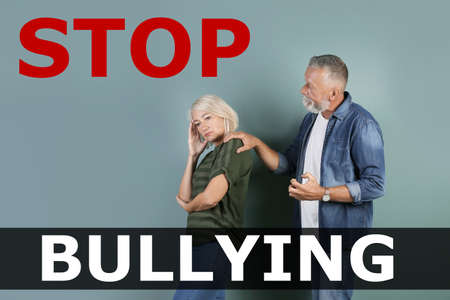 Message STOP BULLYING and mature couple arguing on color background