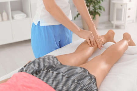 Woman receiving leg massage in wellness center Stock Photo
