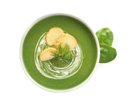 Fresh vegetable detox soup made of spinach with croutons in dish and leaves on white background, top view 版權商用圖片