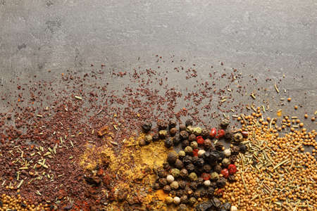 Different aromatic spices and space for text on gray background, top view