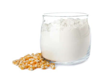 Jar with corn starch and kernels on white background