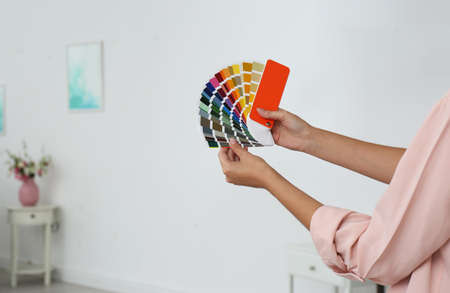Female interior designer with color palette samples indoors. Space for text Standard-Bild