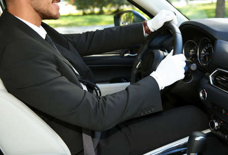 Young driver in luxury car. Chauffeur service