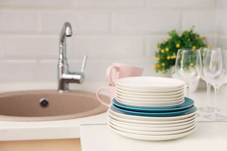 Clean dishes on counter near kitchen sink indoors
