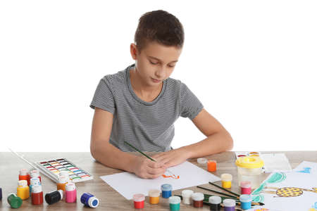 Cute child painting picture at table on white background