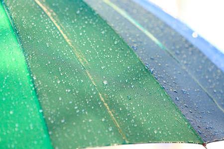 Bright color umbrella under rain outdoors, closeup Stock Photo