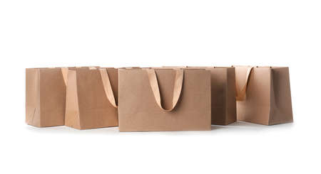 Paper shopping bags with comfortable handles on white background. Mockup for design 版權商用圖片