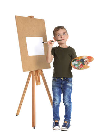 Child painting picture on easel against white background. Space for text