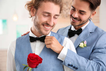 Happy newlywed couple with flower at home Stock Photo