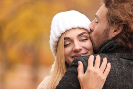 Young romantic couple hugging outdoors on autumn day 스톡 콘텐츠