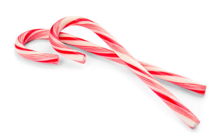 Tasty candy canes on white background. Festive treat