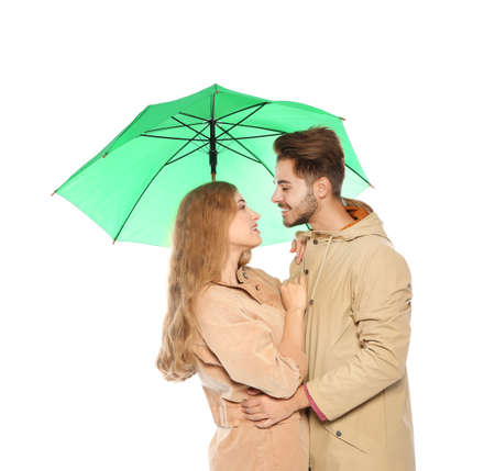 Young romantic couple with bright umbrella on white background Stok Fotoğraf
