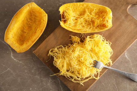 Flat lay composition with cooked spaghetti squash on table