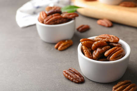 Small dish with tasty pecan nuts served on table. Space for text Фото со стока