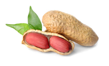 Raw peanuts and leaves on white background. Healthy snack