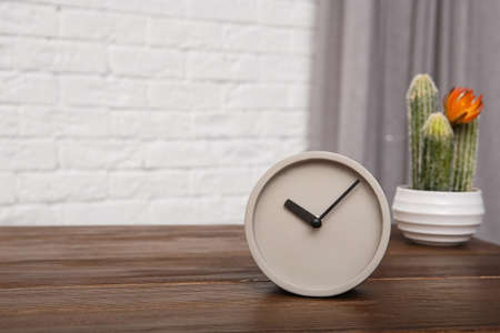 Modern alarm clock on table indoors. Space for text