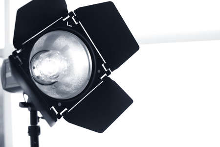 Professional photo studio equipment on light background. Space for text Фото со стока