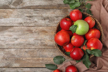 Composition with different apples and space for text on wooden background, top view