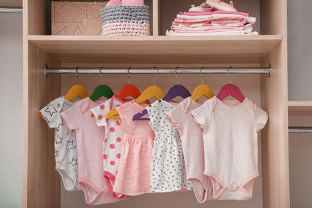 Wardrobe with cute baby clothes and home stuff 免版税图像