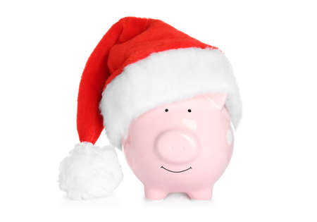 Cute piggy bank with Santa hat on white background 版權商用圖片