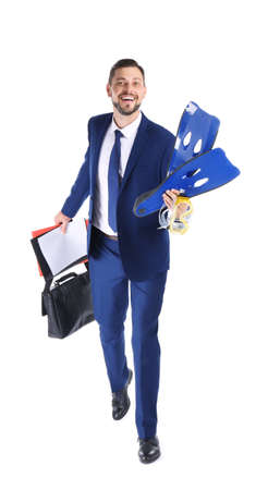 Businessman with diving equipment, briefcase and documents running on white background. Combining life and work
