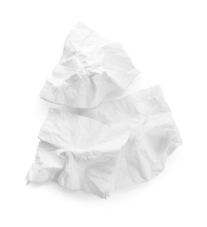 Crumpled paper napkins on white background, top view