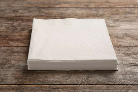Clean napkins on wooden background. Personal hygiene Stock Photo - 112744084