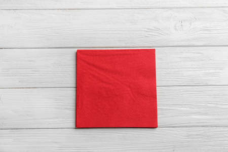 Clean napkins on wooden background, top view. Personal hygiene Stok Fotoğraf
