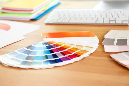 Paint color palette samples on wooden table, closeup