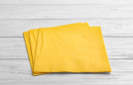 Clean napkins on wooden background. Personal hygiene
