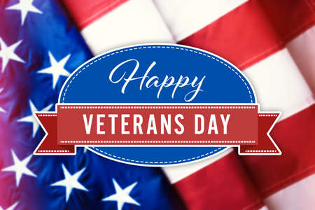 Text HAPPY VETERANS DAY and USA flag on background Stock Photo