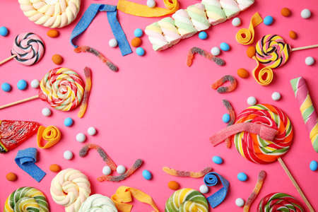Flat lay composition with different yummy candies and space for text on color background Фото со стока