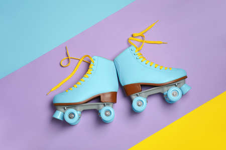 Pair of stylish quad roller skates on color background, top view Stock Photo