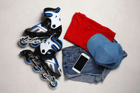 Flat lay composition with inline roller skates on light background
