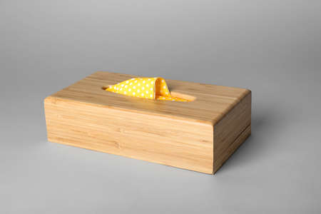 Wooden napkin holder with paper serviettes on gray background Stok Fotoğraf