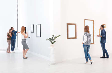 People viewing exposition in modern art gallery 스톡 콘텐츠
