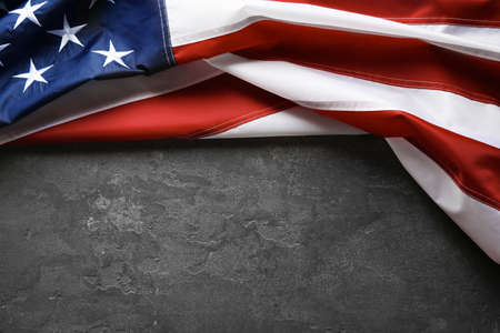 American flag on grey background, top view with space for text 免版税图像