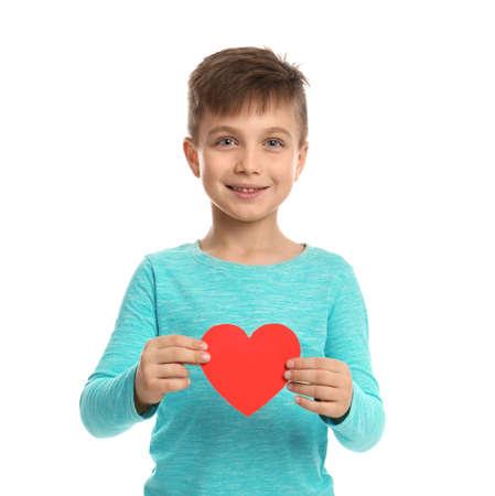Cute boy with decorative heart on white background Standard-Bild