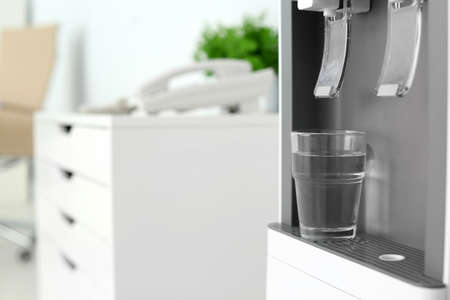 Modern Water Cooler With Glass In Office Closeup Space For Stock Photo Picture And Royalty Free Image Image 113043576